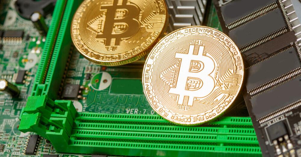 Bitcoin on computer circuit board