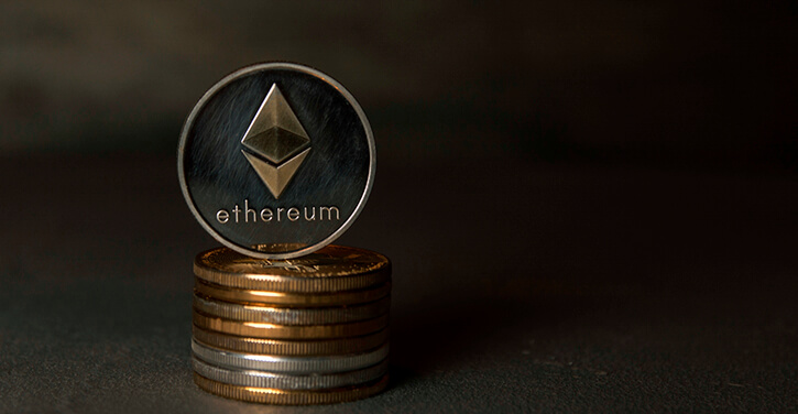 An image of stacked ETH coins