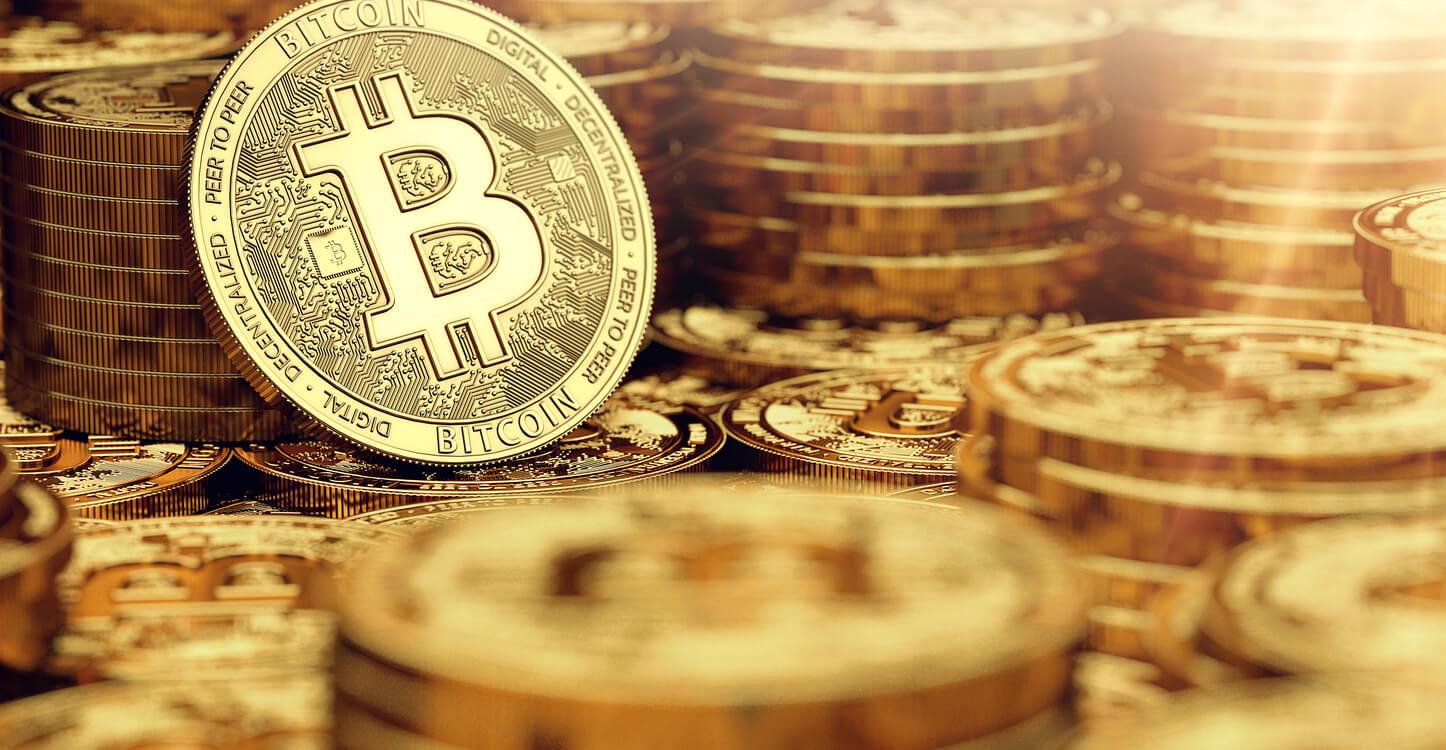 3D closeup image of golden bitcoins
