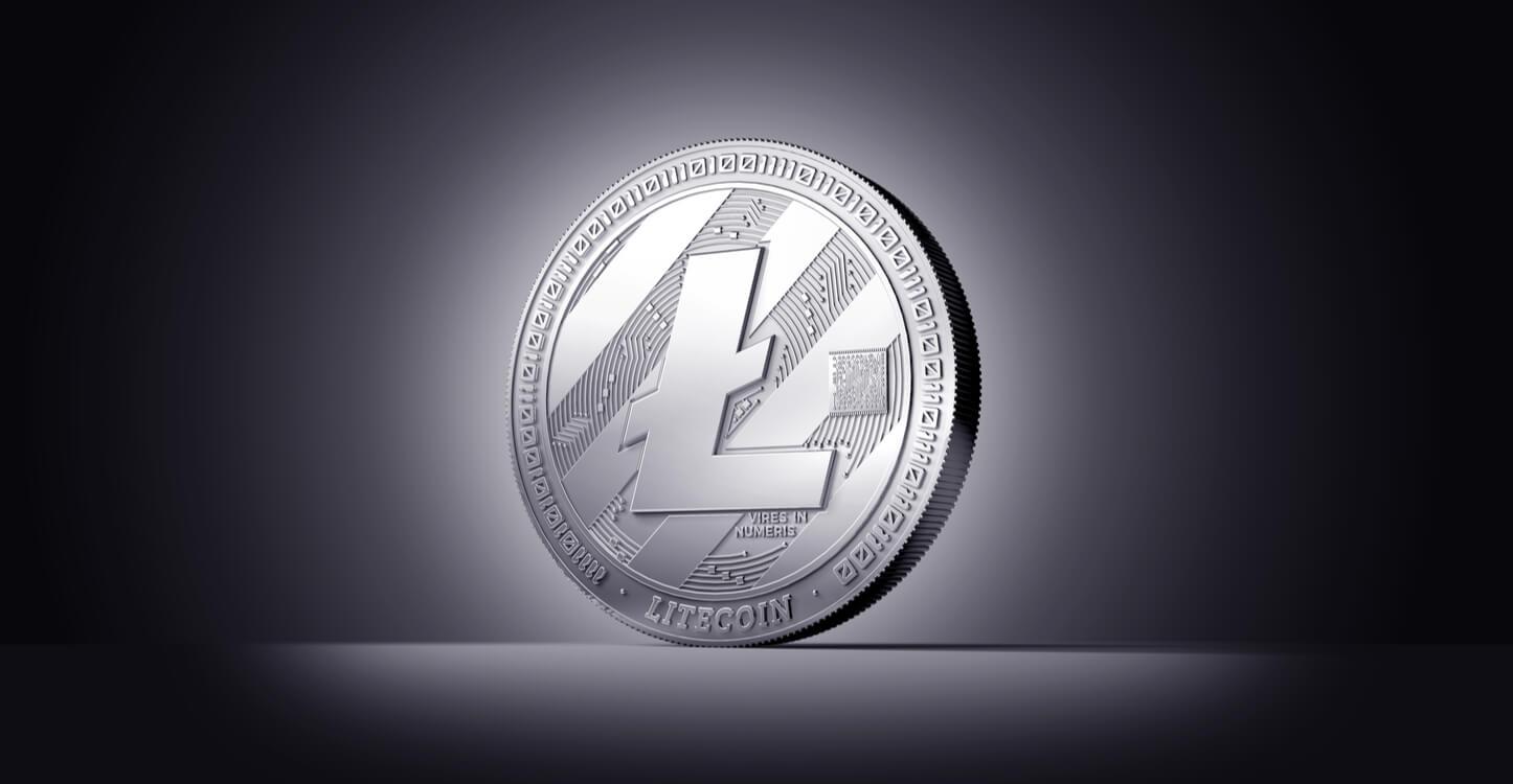 An image of Litecoin illuminated on a dark background