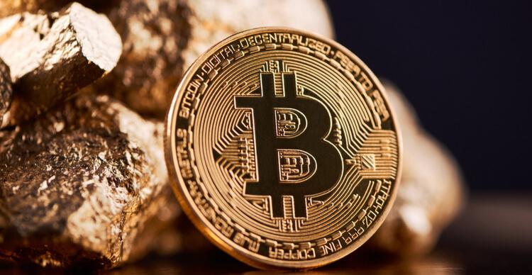 A image representation of Bitcoin alongside gold lumps