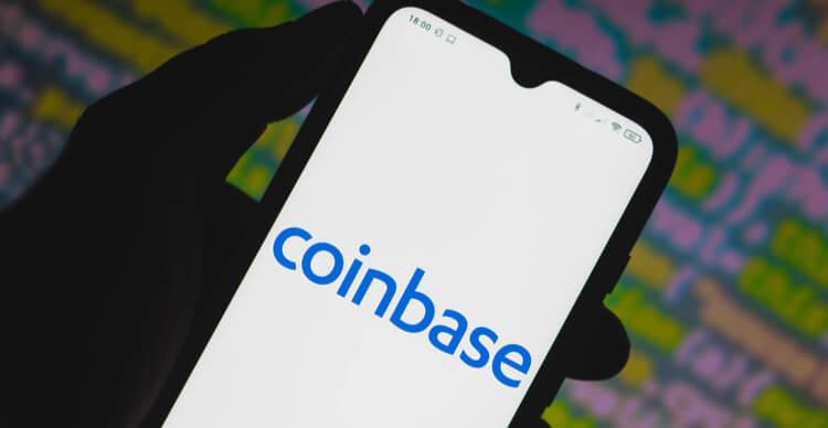 A phone screen displaying the Coinbase logo