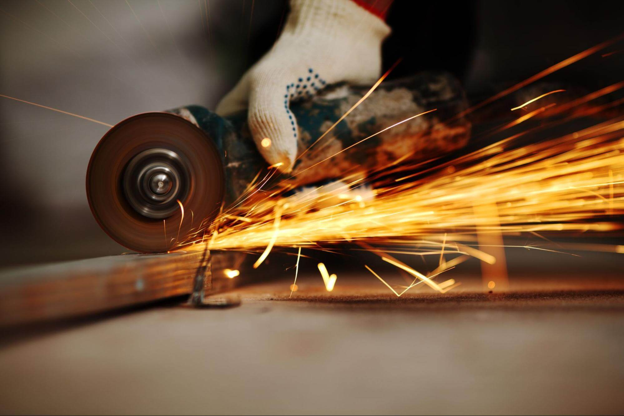 A blade grinds against a piece of metal. Sparks fly