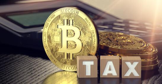 An image of Bitcoin next to a tax calculator